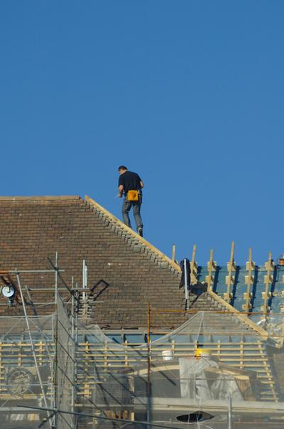 Rome Roofer working on a roof